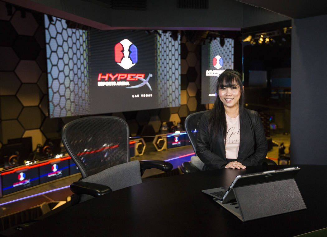 Grant recipient Obe Wan poses for a portrait while exploring the production room during a visit to the HyperX Esports Arena at the Luxor as part of the 1,000 Dreams Fund's BroadcastHER Academy Cha ...