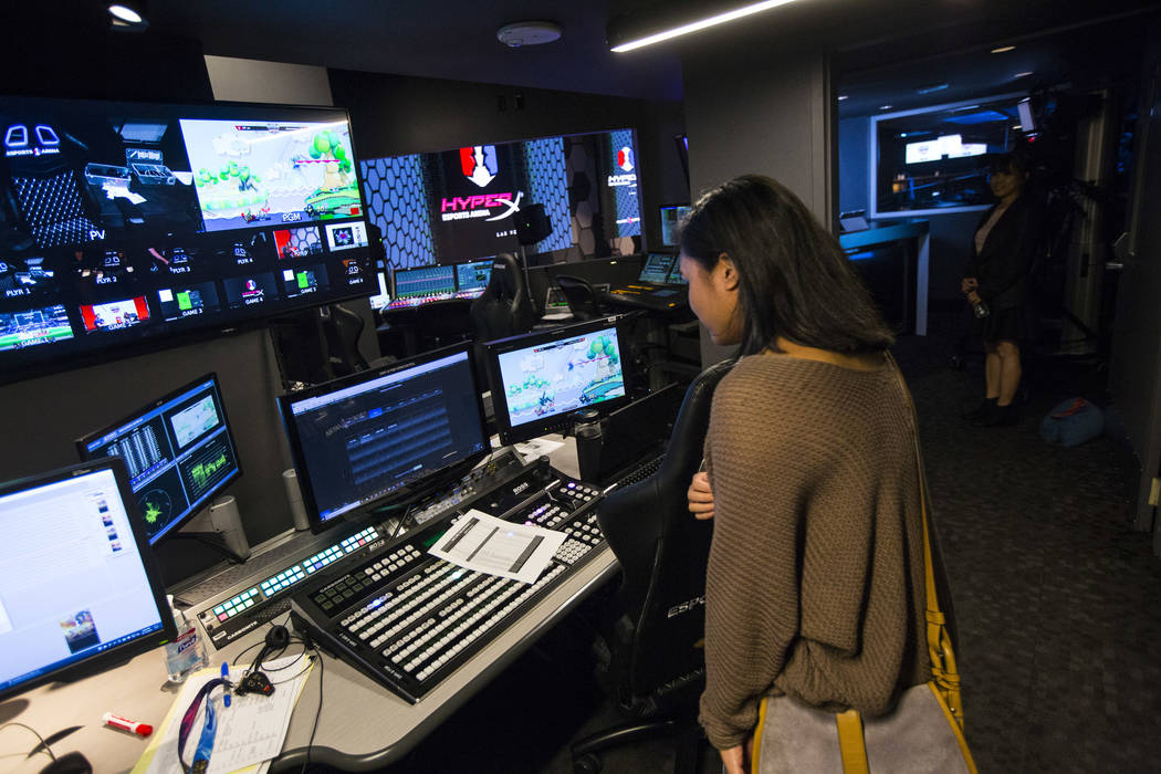 Grant recipient Alexandra de la Cruz explores the production room during a visit to the HyperX Esports Arena at the Luxor as part of the 1,000 Dreams Fund's BroadcastHER Academy Challenge in Las V ...