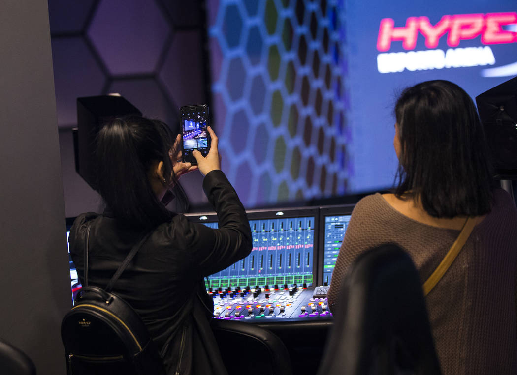 Grant recipient Obe Wan takes a picture while exploring the production room during a visit to the HyperX Esports Arena at the Luxor as part of the 1,000 Dreams Fund's BroadcastHER Academy Challeng ...