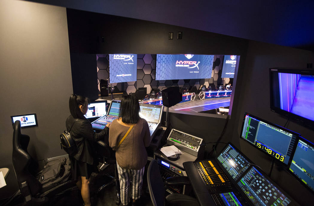 Grant recipients Obe Wan, left, and Alexandra de la Cruz explore the production room during a visit to the HyperX Esports Arena at the Luxor as part of the 1,000 Dreams Fund's BroadcastHER Academy ...