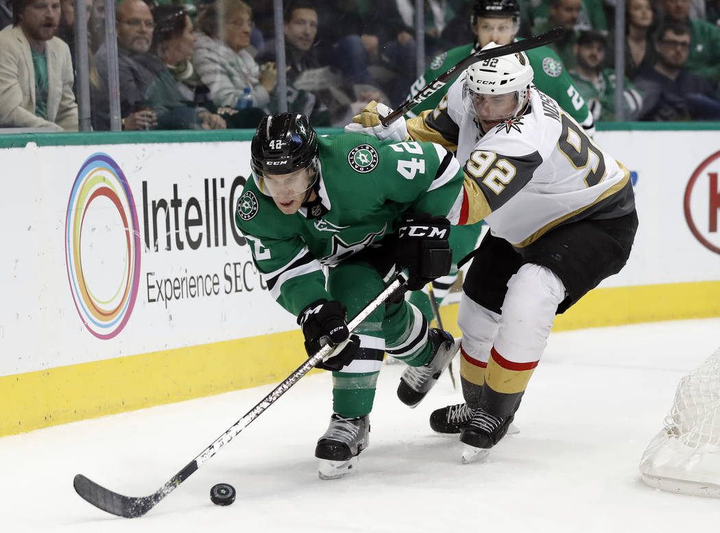 Dallas Stars defenseman Taylor Fedun (42) reaches out for a loose puck in front of Vegas Golden Knights center Tomas Nosek (92) in the second period of an NHL hockey game in Dallas, Friday, March ...