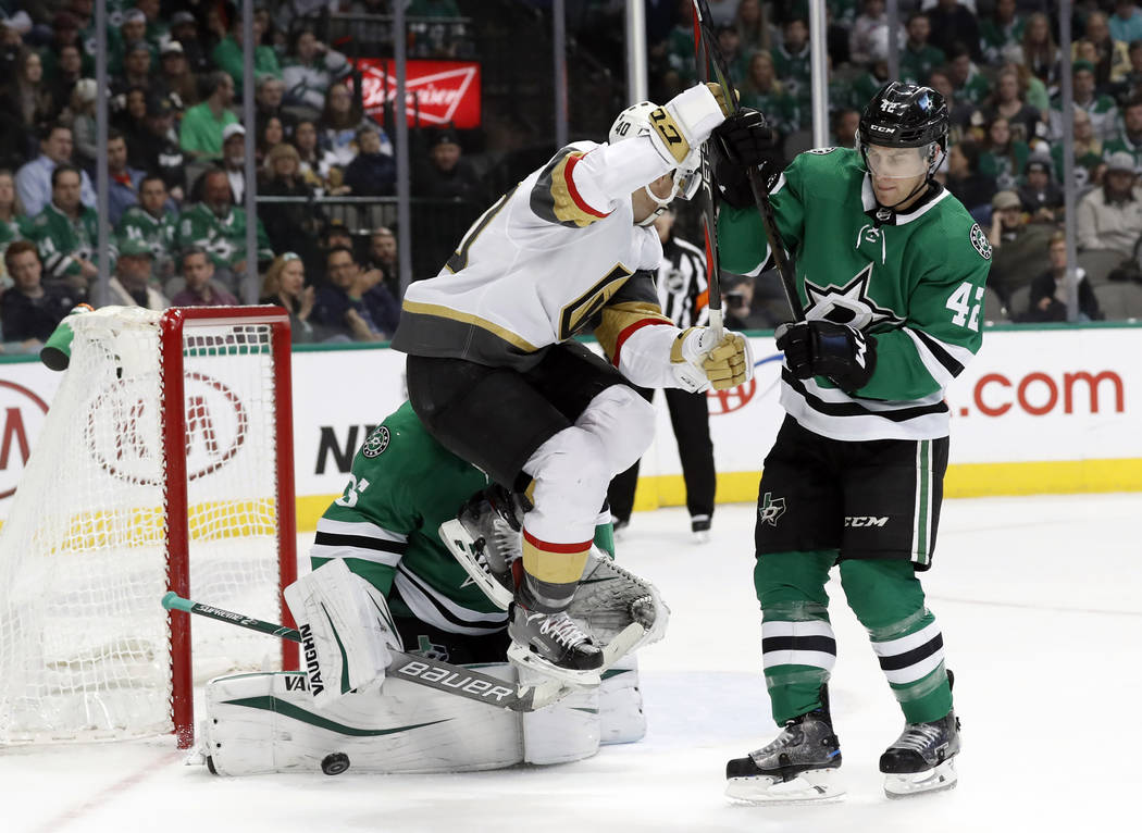 Vegas Golden Knights center Ryan Carpenter (40) leaps over a shot that Dallas Stars' Anton Khudobin blocked as defenseman Taylor Fedun (42) helps defend the net in the second period of an NHL hock ...