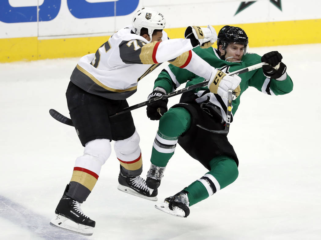 Vegas Golden Knights right wing Ryan Reaves (75) knocks Dallas Stars defenseman Ben Lovejoy (21) off his skates during a collision in the second period of an NHL hockey game in Dallas, Friday, Mar ...