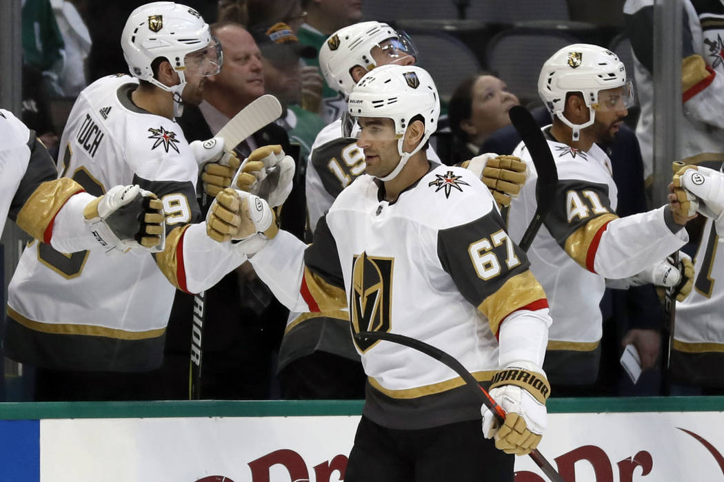Vegas Golden Knights left wing Max Pacioretty (67) is congratulated by the bench after scoring against the Dallas Stars in the first period of an NHL hockey game in Dallas, Friday, March 15, 2019. ...