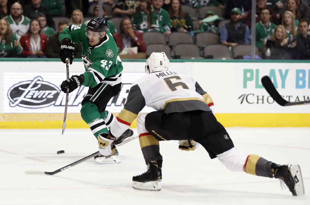 Dallas Stars right wing Valeri Nichushkin (43) takes a shot at the net as Vegas Golden Knights defenseman Colin Miller (6) helps defend in the first period of an NHL hockey game in Dallas, Friday, ...