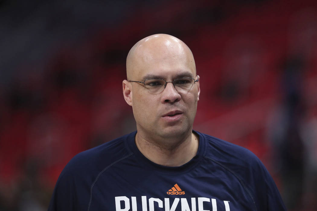 Bucknell head coach Nathan Davis walks off the court after a practice session for an NCAA men's college basketball tournament first-round game, Thursday, March 15, 2018, in Detroit. (AP Photo/Carl ...