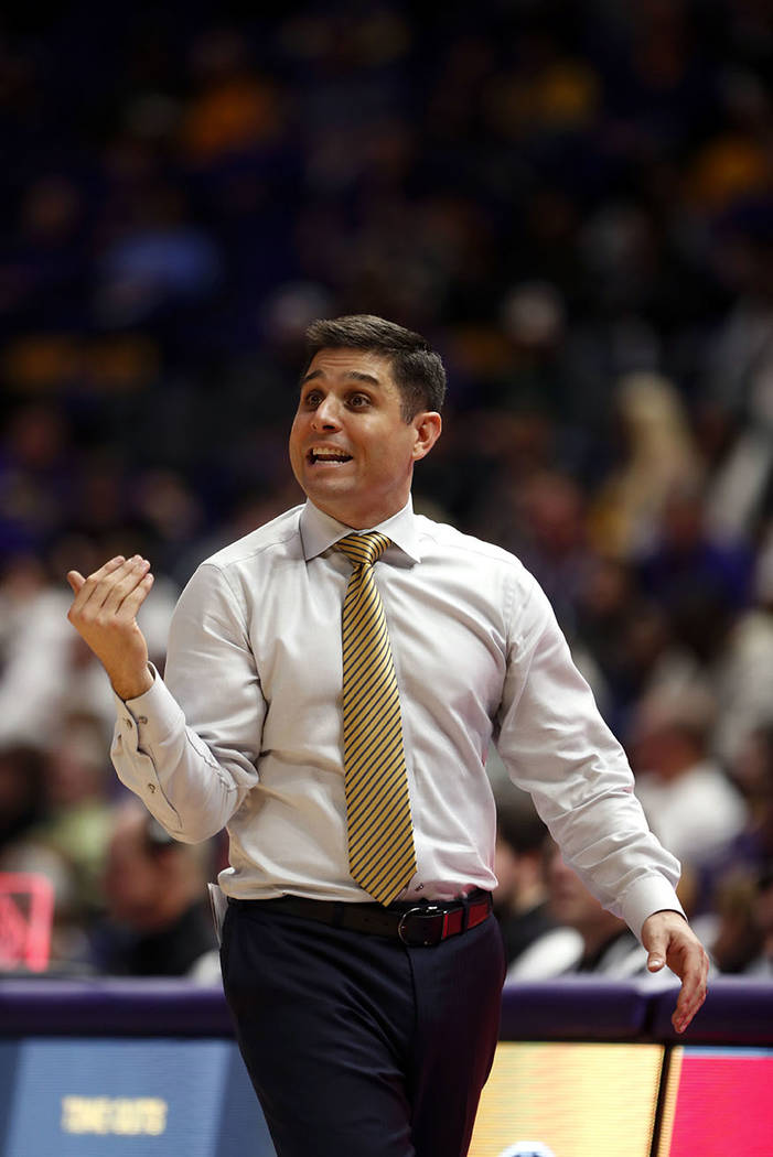 UNC Greensboro head coach Wes Miller calls out from the bench in the second half an NCAA college basketball game against LSU in Baton Rouge, La., Friday, Nov. 9, 2018. (AP Photo/Gerald Herbert)