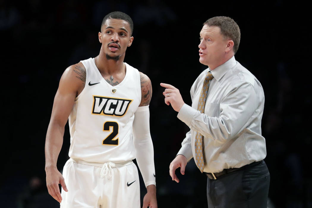 Virginia Commonwealth head coach Mike Rhoades, right, talks to Marcus Evans (2) during the second half of an NCAA college basketball game in the Legends Classic tournament Monday, Nov. 19, 2018, i ...