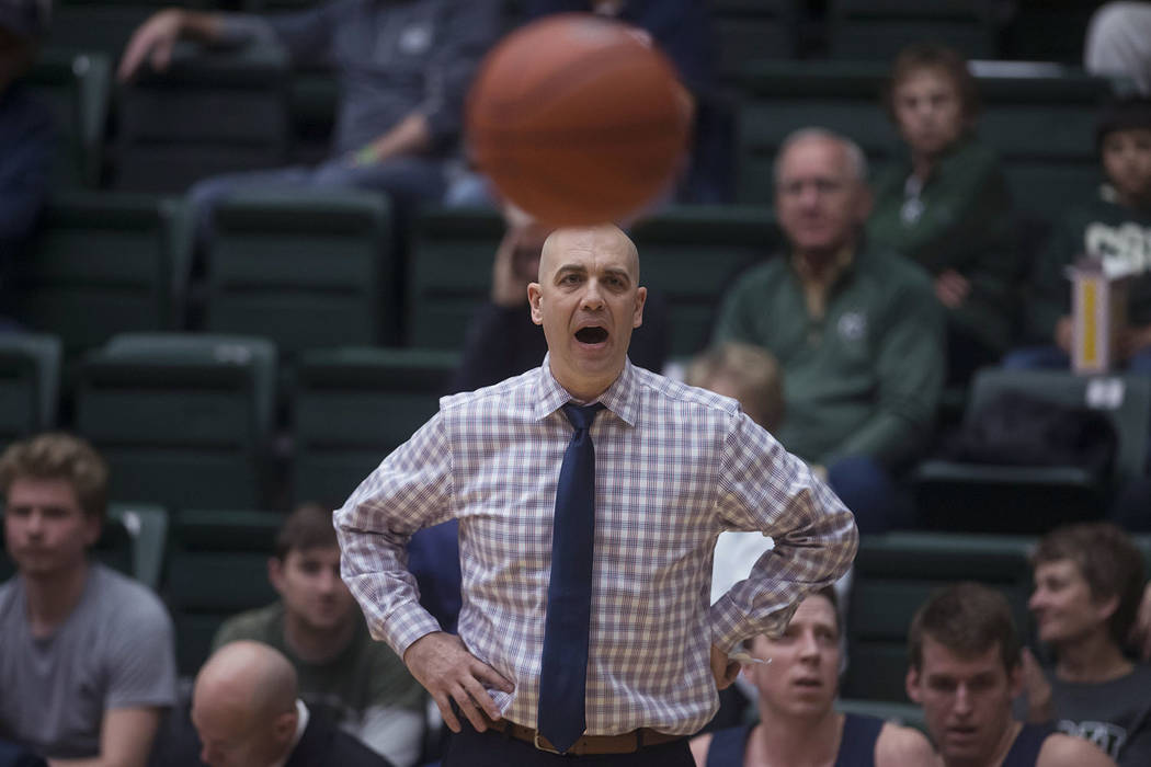 Utah State coach Craig Smith calls out to his team during an NCAA college basketball game against Colorado State on Tuesday, March 5, 2019, in Fort Collins, Colo (Timothy Hurst/The Coloradoan via AP)