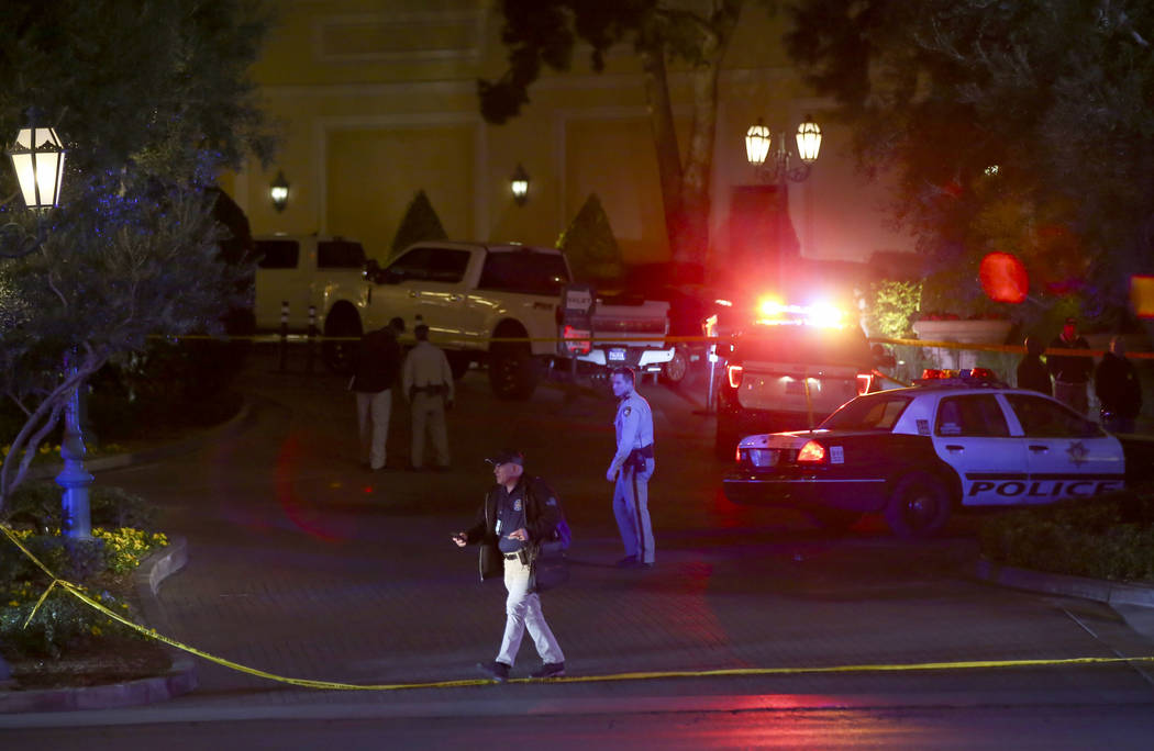 Las Vegas police officers investigate outside of the north valet at the Bellagio after police fired at a robbery suspect in Las Vegas on Friday, March 15, 2019. (Chase Stevens/Las Vegas Review-Jou ...