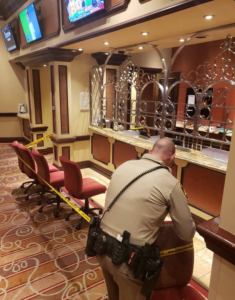 A Las Vegas police officer tapes off an area in the Bellagio after a robbery and officer-involved shooting on March, 15, 2019. (Rick Fuller/Twitter (@gamblindude))