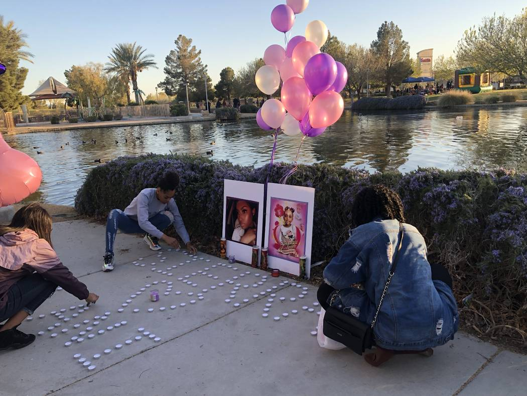 Women light candles during a vigil on Saturday, March 16, 2019, in North Las Vegas for Sierra Robinson, 24, and her daughter, 2-year-old Noelani Robinson. Police said Sierra Robinson, of Las Vegas ...
