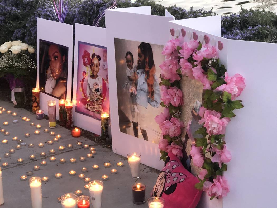 Candles illuminated pictures during a vigil on Saturday, March 16, 2019, in North Las Vegas for Sierra Robinson, 24, and her daughter, 2-year-old Noelani Robinson. Police said Sierra Robinson, of ...