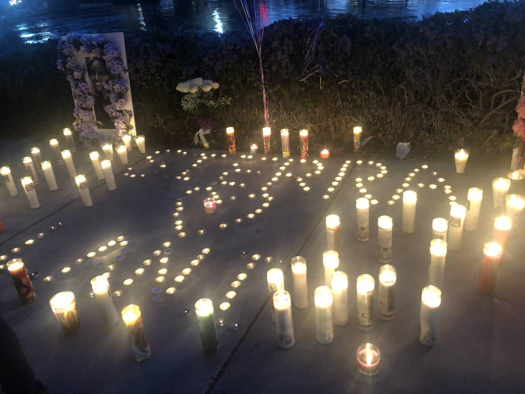 "Candles spelled out ""Sierra"" and ""Lani"" during a vigil on Saturday, March 16, 2019, in North Las Vegas for Sierra Robinson, 24, and her daughter, 2-year-old Noelani Robinson. Police said Sierra Ro ..."