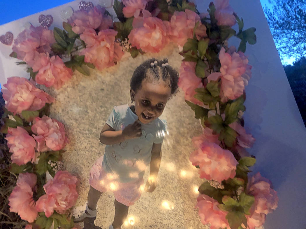 Candles illuminated a picture of 2-year-old Noelani Robinson during a vigil on Saturday, March 16, 2019, in North Las Vegas for the girl and her mother, Sierra Robinson, 24. Police said Sierra Rob ...