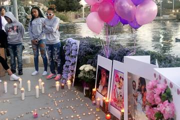 Pasha Weaver, 22, wearing white sunglasses, speaks during a vigil on Saturday, March 16, 2019, in North Las Vegas for her sister and 2-year-old niece: Sierra Robinson and Noelani Robinson. Police ...