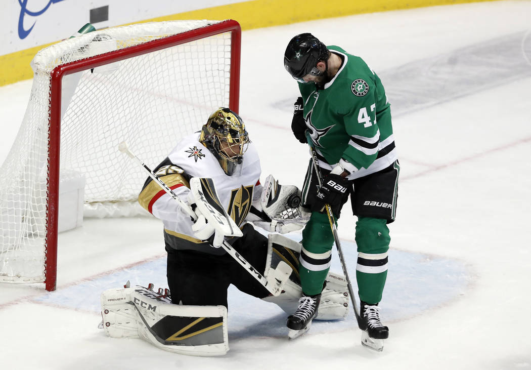 Vegas Golden Knights goaltender Marc-Andre Fleury (29) gloves a shot under pressure from Dallas Stars right wing Alexander Radulov (47) in the third period of an NHL hockey game in Dallas, Friday, ...