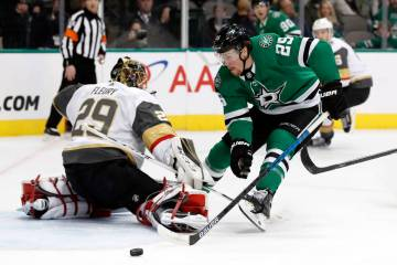 Vegas Golden Knights goaltender Marc-Andre Fleury (29) deflects a shot as Dallas Stars right wing Brett Ritchie (25) pressures the net in the first period of an NHL hockey game in Dallas, Friday, ...
