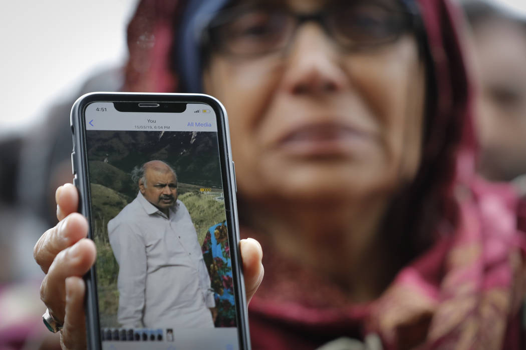 Akhtar Khokhur, 58, shows a picture of her missing husband Mehaboobbhai Khokhar during an interview outside an information center for families, Saturday, March 16, 2019, in Christchurch, New Zeala ...