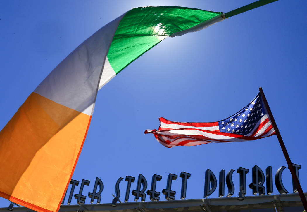 Irish and American flags flutter in the wind at the 53rd Annual Southern Nevada Sons & Daughters of Erin St. Patrick's Day parade in Henderson, Nev., on Saturday, March 16, 2019. Brett Le Blan ...