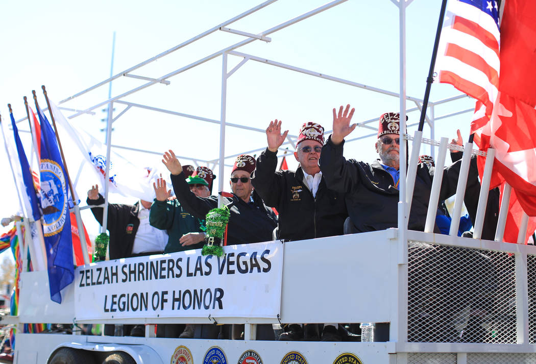 The Zelzah Shriners Las Vegas Legion of honor waves to the crowd in the 53rd Annual Southern Nevada Sons & Daughters of Erin St. Patrick's Day parade in Henderson, Nev., on Saturday, March 16, ...