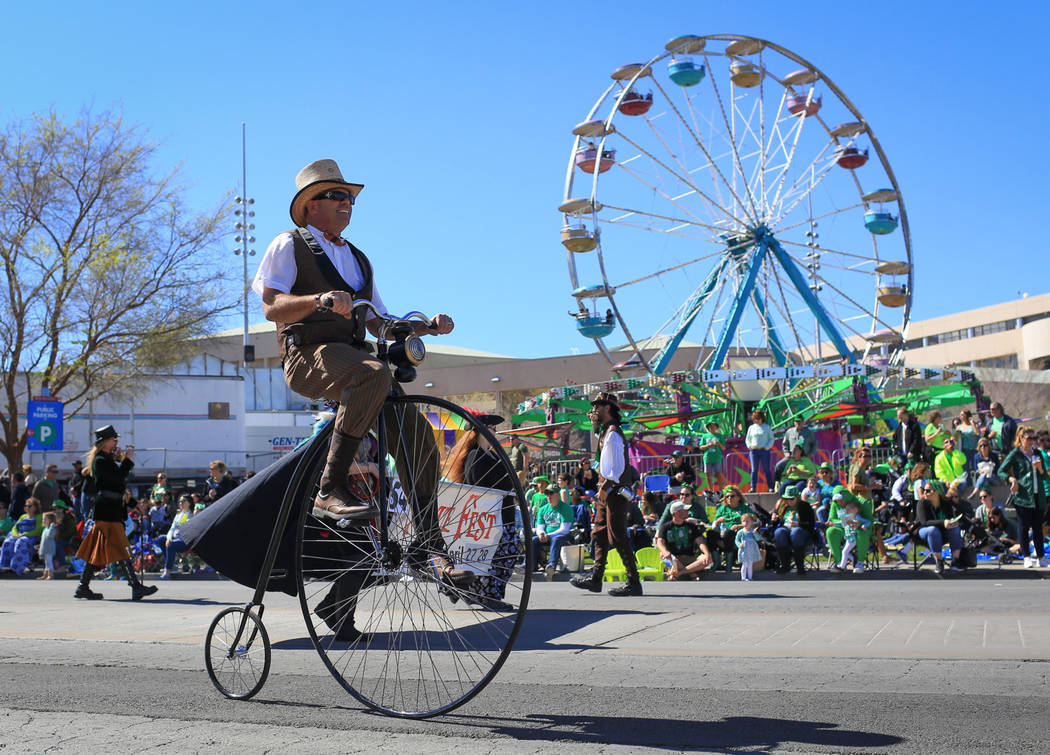 Joe Archer rides a Penny-farthing in the 53rd Annual Southern Nevada Sons & Daughters of Erin St. Patrick's Day parade in Henderson, Nev., on Saturday, March 16, 2019. Brett Le Blanc/Las Vegas ...