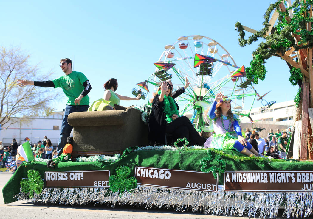 The Super Summer Theatre float passes in front of the fair rides at the 53rd Annual Southern Nevada Sons & Daughters of Erin St. Patrick's Day parade in Henderson, Nev., on Saturday, March 16, ...