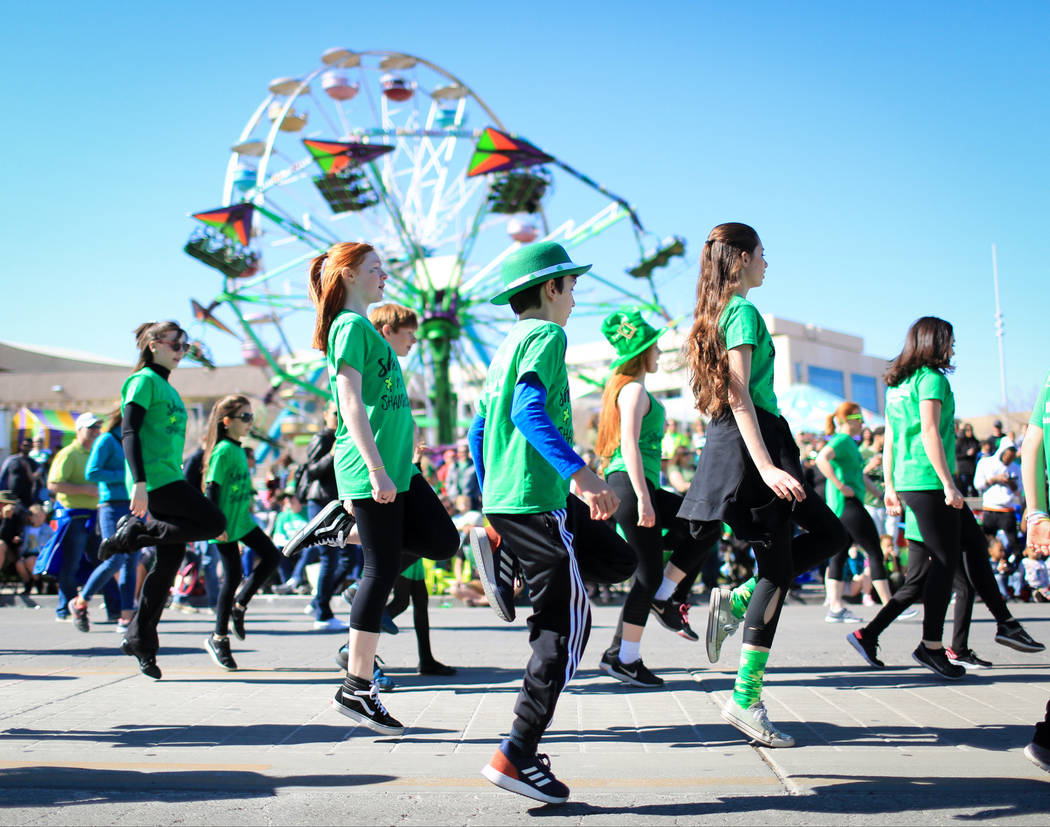 Dancers with the Scoil Rince Ni Riada Irish Dance school perform in the 53rd Annual Southern Nevada Sons & Daughters of Erin St. Patrick's Day parade in Henderson, Nev., on Saturday, March 16, ...
