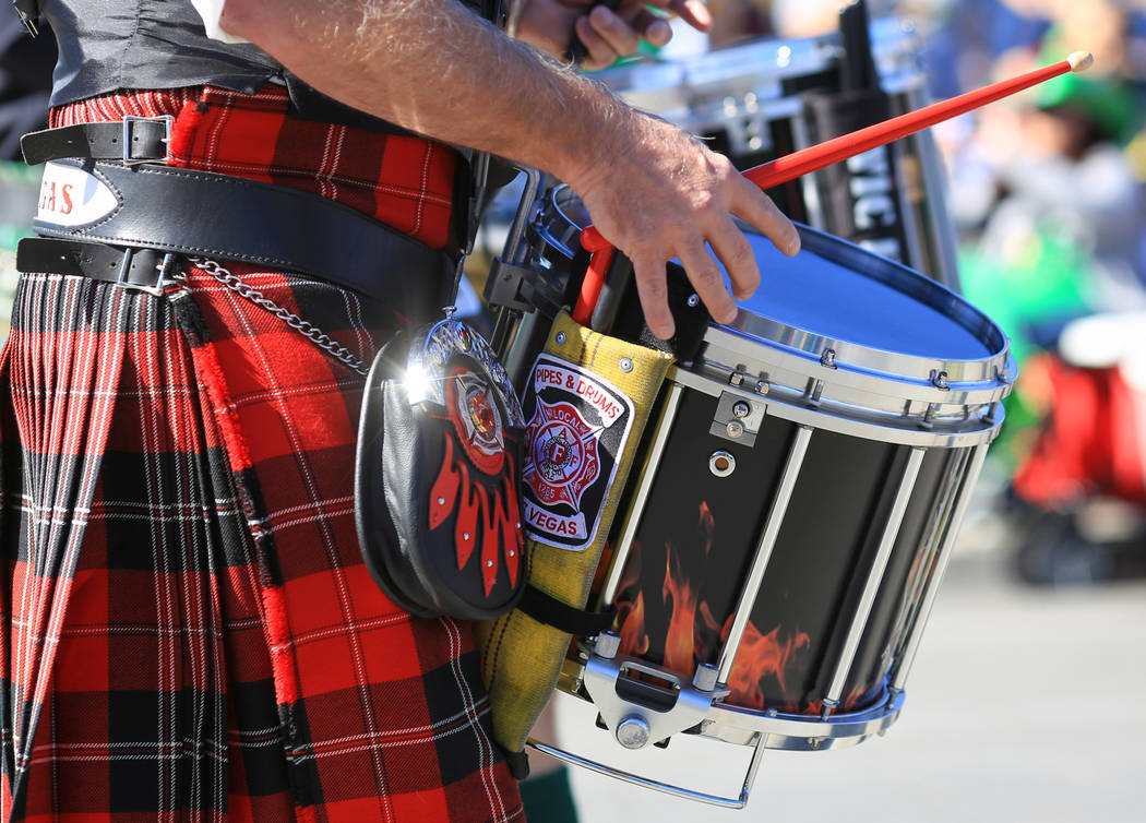A drummer with the Las Vegas Emerald Society march in the 53rd Annual Southern Nevada Sons & Daughters of Erin St. Patrick's Day parade in Henderson, Nev., on Saturday, March 16, 2019. The Eme ...