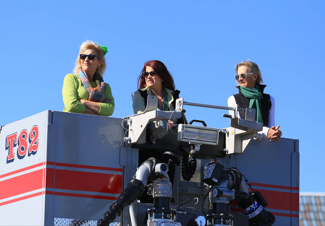 Henderson city mayor Debra March, middle, rides in fire truck in the 53rd Annual Southern Nevada Sons & Daughters of Erin St. Patrick's Day parade in Henderson, Nev., on Saturday, March 16, 20 ...