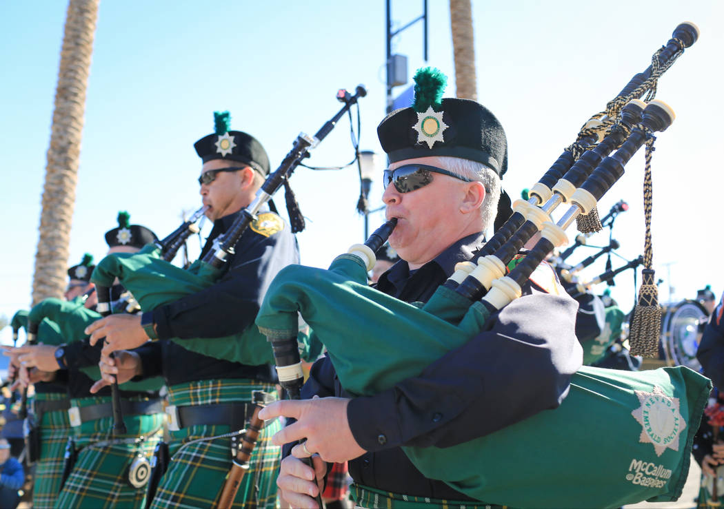Bagpipers with the Las Vegas Emerald Society march in the 53rd Annual Southern Nevada Sons & Daughters of Erin St. Patrick's Day parade in Henderson, Nev., on Saturday, March 16, 2019. The Eme ...