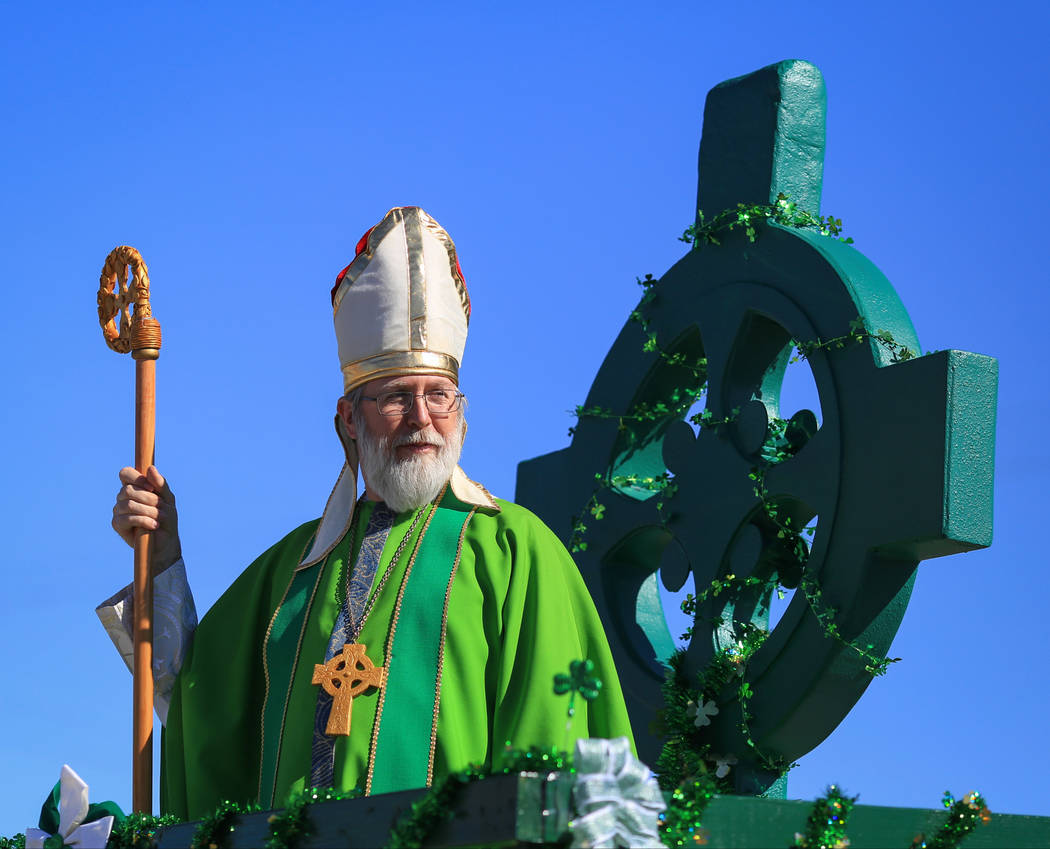 Scott Rice, with Southern Nevada Sons and Daughters of Erin, dresses as Saint Patrick to lead the the 53rd Annual Southern Nevada Sons & Daughters of Erin St. Patrick's Day parade in Henderson ...