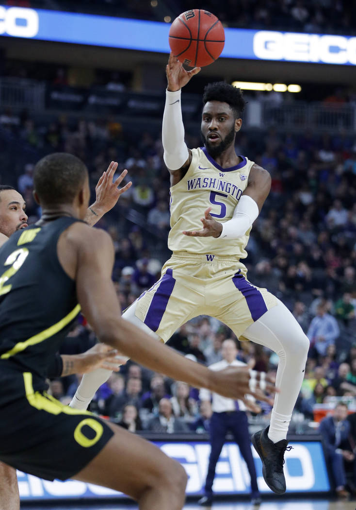 Washington's Jaylen Nowell (5) passes the ball against Oregon during the first half of an NCAA college basketball game in the final of the Pac-12 men's tournament Saturday, March 16, 2019, in Las ...
