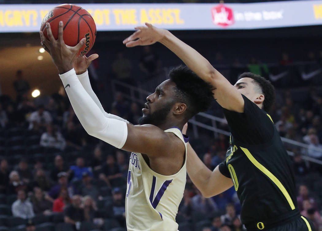 Washington's Jaylen Nowell shoots around Oregon's Will Richardson during the first half of an NCAA college basketball game in the final of the Pac-12 men's tournament Saturday, March 16, 2019, in ...