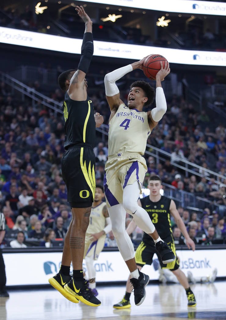 Washington's Matisse Thybulle shoots over Oregon's Kenny Wooten during the first half of an NCAA college basketball game in the final of the Pac-12 men's tournament Saturday, March 16, 2019, in La ...