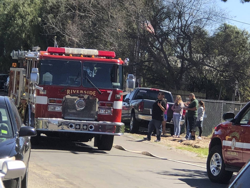Riverside Fire Department crews arrive at the scene of a small plane crash on Robinson Street in La Sierra area in Riverside, Calif., Saturday, March 16, 2019. (Brian Rokos/The Orange County Regis ...