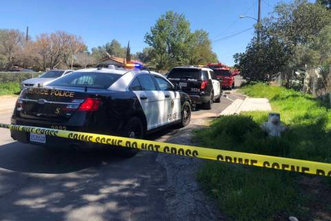 Riverside Police and Fire Department crews vehicles are seen near the site of a small plane crash on Robinson Street in the La Sierra area in Riverside, Calif., Saturday, March 16, 2019. (Brian Ro ...