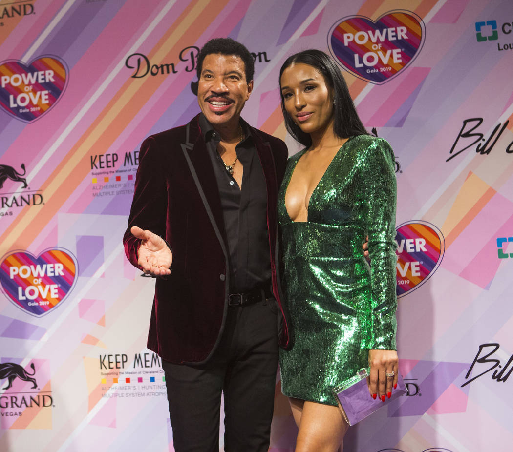 Lionel Richie, left, and his girlfriend, Lisa Parigi, pose on the red carpet for Keep Memory Alive's 23rd annual Power of Love gala, raising money for Cleveland Clinic Lou Ruvo Center for Brain He ...