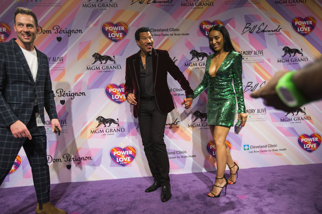 Lionel Richie, center left, and his girlfriend Lisa Parigi walk the red carpet for Keep Memory Alive's 23rd annual Power of Love gala, raising money for Cleveland Clinic Lou Ruvo Center for Brain ...