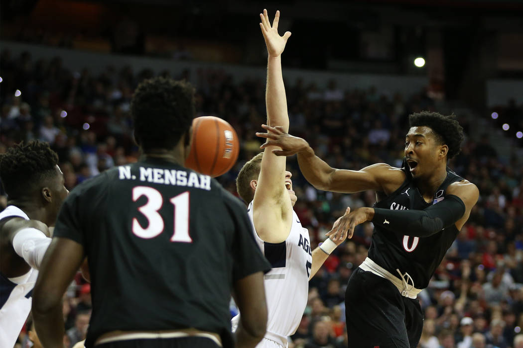 San Diego State Aztecs forward Jalen McDaniels (5) makes a pass under pressure from Utah State Aggies guard Sam Merrill (5) in the first half of the Mountain West tournament men's basketball champ ...