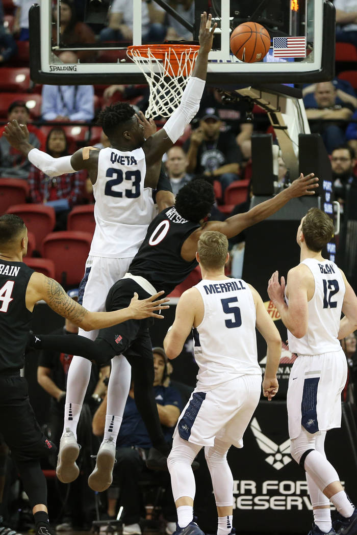Utah State Aggies center Neemias Queta (23) makes a block against San Diego State Aztecs guard Devin Watson (0) in the second half of the Mountain West tournament men's basketball championship gam ...
