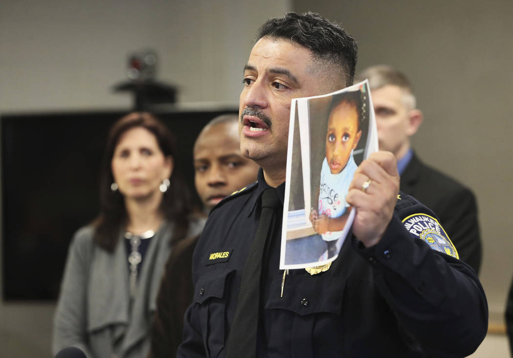 In this Friday, March 15, 2019, photo, Milwaukee Police Chief Alfonso Morales holds a photo of 2-year-old Noelani Robinson as he speaks at a news conference at the Police Administration Building i ...