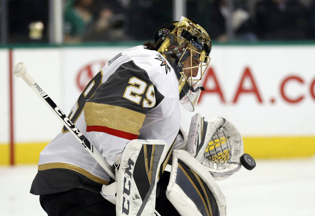 Vegas Golden Knights goaltender Marc-Andre Fleury (29) reaches out to glove a shot from the Dallas Stars in the first period of an NHL hockey game in Dallas, Friday, March 15, 2019. (AP Photo/Tony ...