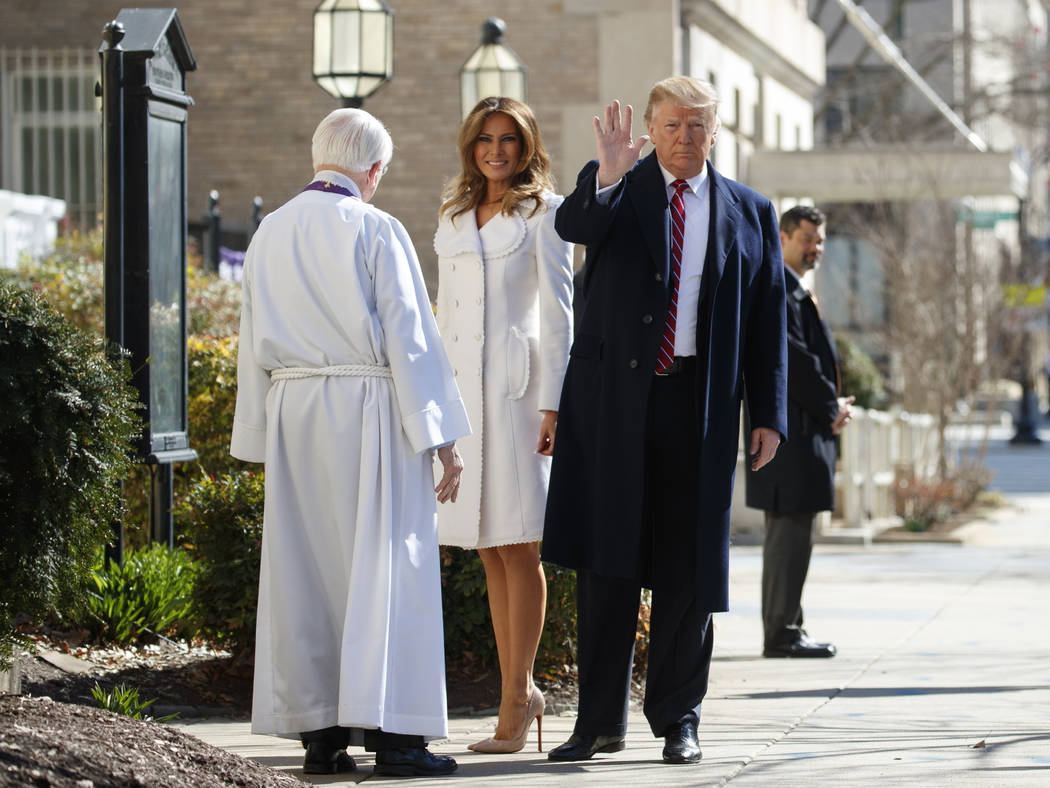 President Donald Trump with first lady Melania Trump, and Reverend Bruce McPherson, waves to media as he arrives to attend service at Saint John's Church in Washington, Sunday, March 17, 2019 (AP ...