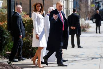 President Donald Trump and first lady Melania Trump, with Reverend Bruce McPherson, walk to their motorcade after attending service at Saint John's Church in Washington, Sunday, March 17, 2019, en ...