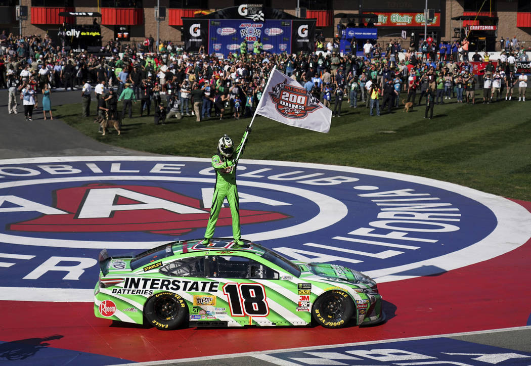 Kyle Buschs stands on his car after winning the NASCAR Cup Series auto race at Auto Club Speedway in Fontana, Calif., Sunday, March 17, 2019. (AP Photo/Rachel Luna)