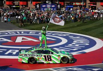 Kyle Buschs stands on his car after winning the NASCAR Cup Series race at Auto Club Speedway in Fontana, Calif., Sunday, March 17, 2019. (AP Photo/Rachel Luna)