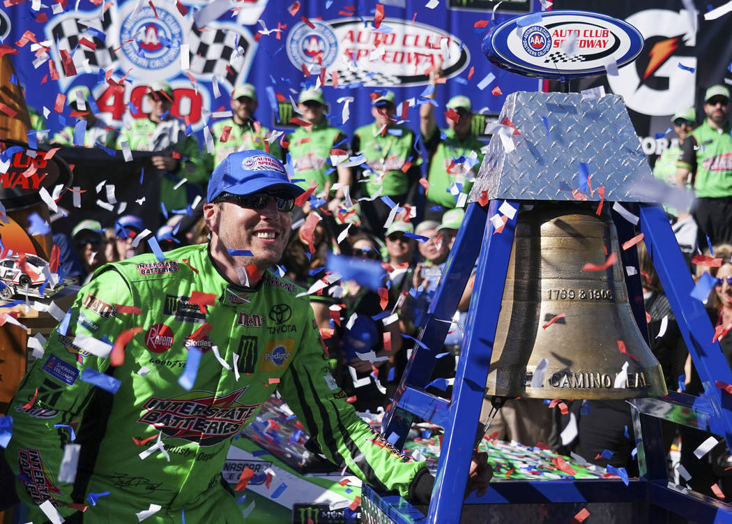 Kyle Busch celebrates after winning a NASCAR Cup Series auto race at Auto Club Speedway, in Fontana, Calif., Sunday, March 17, 2019. (AP Photo/Rachel Luna)