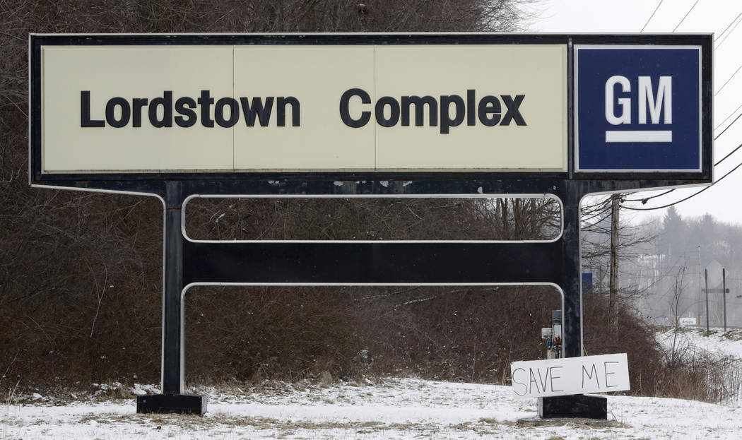 """A """"Save Me"""" sign rests against the Lordstown Complex sign, Wednesday, March 6, 2019, in Lordstown, Ohio. General Motors' sprawling Lordstown assembly plant near Youngstown is about to en ..."""