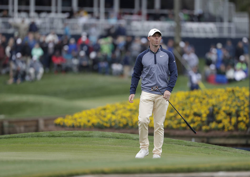 Rory McIlroy, of Northern Ireland, reacts to his putt on the 17th green during the final round of The Players Championship golf tournament Sunday, March 17, 2019, in Ponte Vedra Beach, Fla. (AP Ph ...